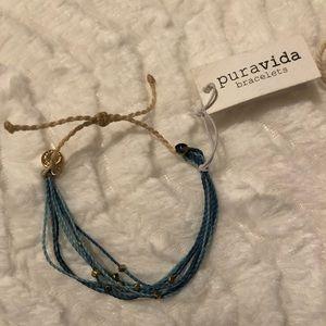 Pura Vida multi color blue with gold bracelet